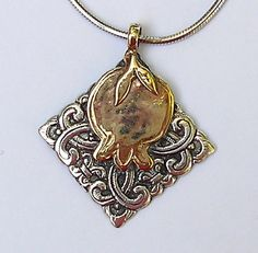 Pomegranate on ornamented pendant with a by HedvaElanyJewelry