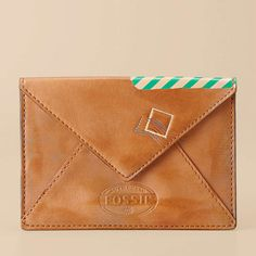 Fossil, Our most vintage-inspired collection features a perfectly sized leather envelope sleeve. During the day, it holds your necessities and slips easily into a larger bag. At night, it doubles as a stylish clutch.
