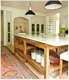a rustic island like this would be perfect for the laundry room... a girl can…