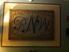 Took an old picture I no longer liked and sanded away the picture. Then used as a blank canvas for a monogram of our initials for our Master Bedroom.  I free handed the initials and the left the Greek key pattern around the border.