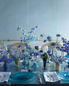 Blue wedding-antique Venetian glass with single-flower arrangements of cornflowers, muscari, nigella, delphiniums, and anemones brings the color center stage. Round Table Centerpieces, Modern Wedding Centerpieces, Wedding Decorations, Centerpiece Ideas, Round Tables, Purple Centerpiece, Eucalyptus Centerpiece, Vase Ideas, Seeded Eucalyptus