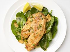 Lemon-Garlic Tilapia with Spinach Recipe : Food Network Kitchen : Food Network - FoodNetwork.com