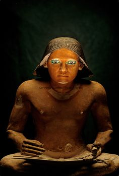An Old Kingdom scribe from a 5th dynasty tomb in Saqqara sits in the classic pose of a high official.  His left hand unrolls a papyrus scroll while the right rests on the document. Writing in Egypt was invented to keep records of the estates in ancient Egypt.  As such, a scribe was a position of great honor and prestige. The Egyptian Museum, Cairo, Egypt,Egypt's Old Kingdom, Scribe, Egyptian Museum, Cairo
