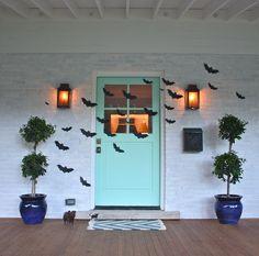 A stylish #Halloween front door with black #bats!