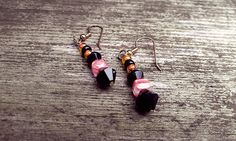 Black and orange dangle earrings by thedragonsdencrafts on Etsy