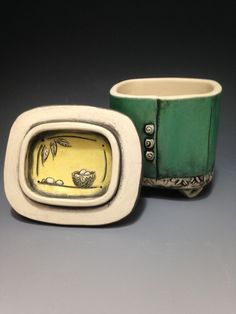Hand built, beautiful lidded clay boxes.