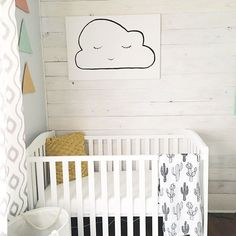 Instagram @BethanyMPoteet // Gender neutral nursery with cloud painting, cactus Modern Burlap swaddle, and shiplap.