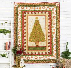 Bring this heartwarming tree to any room with the Christmas Cheer Quilt Kit! You'll receive holiday-inspired Robert Kaufman prints from the Winter's Grandeur Collection along with a downloadable pattern — everything you need to get started on your top.