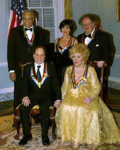 James Earl Jones, Chita Rivera, James Levine, from left to right back row, with Paul Simon and Elizabeth Taylor, from left to right front row, pose for a picture as Kennedy Center Honorees for their lifetime contributions to the performing arts at the U.S. State Department, Saturday, Dec. 7, 2002, in Washington.