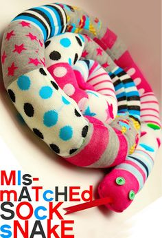 DIY: Mismatched Sock Snake - tutorial shows how to make this using socks, filler and thread. Sew a Sock Snake! Sock Crafts, Fabric Crafts, Crafts For Kids, Arts And Crafts, Scrap Fabric, Fabric Dolls, Sewing Toys, Sewing Crafts, Sewing Projects