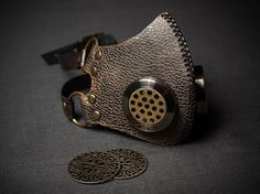 A handmade SteamPunk Mask Gaz Mask Victorian Mask Steam Punk Mask Respirator stylized old bronze. Made of genuine leather. Eyepieces made of