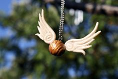 Harry Potter Golden Snitch Pendant! Alexsmisfittoys has a tutorial on this on Youtube.