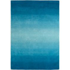 """Peacock Ombre Stripe Rug - 5x8    $249.95  Strut your decorative stuff with this gorgeous hand-woven wool rug. Varying shades of peacock blue contrast beautifully to neutral upholstered furnishings. But you already knew that, right?        Blue      60""""W x 0.75""""D x 96""""H      Wool      Hand-woven      Exclusively Pier 1 Imports"""