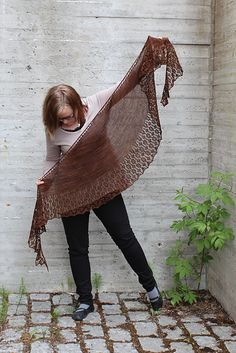 Easy lace shawl. The size is totally adjustable! You may work stockinette as long as you wish. You may also repeat lace pattern as many times as you wish. :)