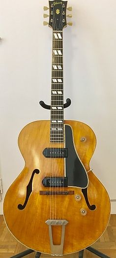 Top-of-the-line. The king. Top banana. The mostest. Top dog. The big daddy. All these descriptions apply to the ES-300, Gibson's first deluxe electric guitar.A Beautiful and rare 1950 Gibson ES-300 with Natural Maple Body and 2 Incredible Sounding P90 Pickups! Features also include Bound Rosewood Fingerboard, Double-Paralellogram Inlays, 2 Volume/1 Master Volume Barrel Knobs and Includes the Original Hard Shell Case! All original, perfect working condition. 1 of only 41 made...