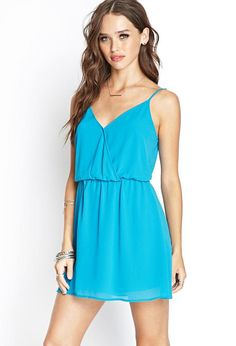 Style Deals - Woven from a soft chiffon fabric, this cami dress features a surplice front and adj...