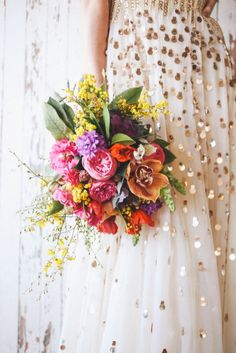 Bright flowers and metallic dress