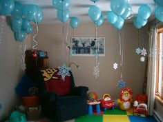 Snowflakes hanging from balloons. Would be cute to scatter these around the room.