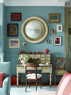 """An evolving salon wall of art surrounds a French mirror. """"I have a fetish for convex mirrors,"""" Sheila says. See more of this gorgeous New York City apartment in """"Inside Designer Sheila Bridgess Ravishing Home in Harlem"""" on the One Kings Lane Style Guide."""