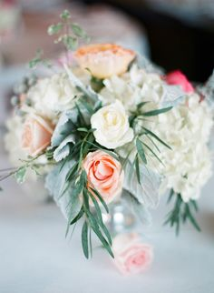 #Peach #wedding color palette inspiration- #flower #centerpieces. See the post at http://tulleandtwine.com/2013/11/19/feeling-peachy