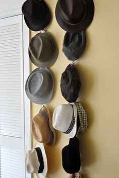 DIY Hat Storage: Take a piece of twine and some metal art clips (the kind with holes in the top). Tie art clips about a foot apart on the twine, hang it from the wall or ceiling and attach your hats.  Great for storing on a closet wall or back of a door.  Going to try this with my boys' growing collection of baseball hats.