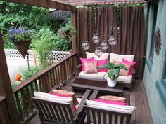 Ideas for hanging curtains on patio . . . love the lanterns, too!
