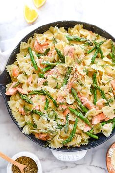 Creamy Bow Tie Pasta with Salmon and Asparagus :: Leftover salmon gets a recipe remake with bowtie pasta, fresh asparagus, and dill in this super simple Parmesan cream sauce that makes meal prep a breeze. | foodiecrush.com