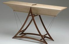 'FULCRUM' #CONSOLE #TABLE IN #WALNUT & #MAPLE. This #design was inspired by some photographs taken of a #yacht, standing out of the water on trestles in a Cornish boatyard. At http://www.makerseye.co.uk/designers/h/patrick-howlett/fulcrum-console-table-in-walnut-maple/ #MakersEye #bespoke #MadeInBritain #furniture #design #BritishCraftsmanship #interiors #lifestyle #BritishLuxury
