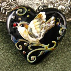 Wow! How charming is this?  Lampwork Love Bird Midnight Heart focal bead