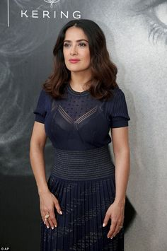 Raising the bra: The actress, who turns 50 in September, looked sensational in a semi-sheer navy dress, which showcased a hint of her black lace bra