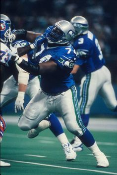 Tackle James Atkins of the Seattle Seahawks blocks against the Denver Broncos at the Kingdome in Seattle Washington on Ocotber 1 1995 The Seahawks. Tackle Football, Football Team, Seattle Seahawks, Denver Broncos, Seahawks Pictures, X League, Football Photos, 12th Man, Seattle Washington