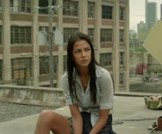 Lola from brick mansions. She's one badass chick for a waitress who doesn't want to fight she sure as hell holds her own.