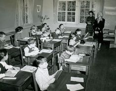Youngsters engrossed in their studies during a typical 1940's school day.  My how times have changed