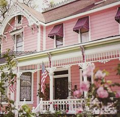 Pink and white gingerbread porch