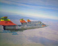 Three F-104s in flight formation.
