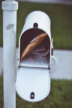 Really like the colour and composition of this simple portrait of a mailbox.