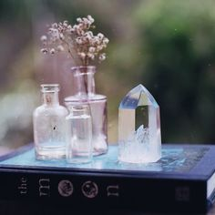 Like this idea to use crystals to help layer my bookshelf. No more bottles though! i have too many!