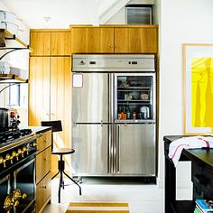 Brass, stainless steel, wood, and oversize art--who says a kitchen is just a workspace? This is a style statement.