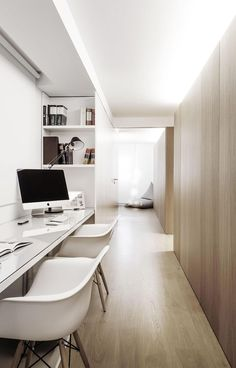 Interior Design Idea - 13 Examples Of Desks In Hallways // Soft lighting from above diffuses throughout the hallway that houses this home office. Shelves built into the sides of the office provide storage and the desk is long enough to provide work spaces for two people.