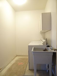 Modern Laundry Room Makeover (Before Painting, with a cat in the sink)