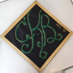Monogram in green and gold for a #BaylorGrad cap!