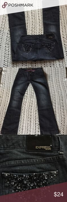 """Dark wash EXPRESS jeans ~sequin pockets Sz. 8 NEAT Washed & worn once!! Excellent new like condition! Women's size 8 pair of """"Stella Boot Cut"""" EXPRESS jeans! A very dark blue wash-almost black w/a hint of factory washed look. These are low rise, have some stretch, are super comfy, super stylish & have AWESOME back pockets w/A sequin embellished type design in shiny black, w/a silverish tone as well! Super neat! ❤️️ The back waist tag is also embellished w/black sequins & silver hardware that…"""
