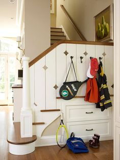 Clutter will congregate at the front door and foot of the stairs no matter how hard to try to retrain the family. Use hooks at kid-height and drawers in the understairs space as strategically placed storage.