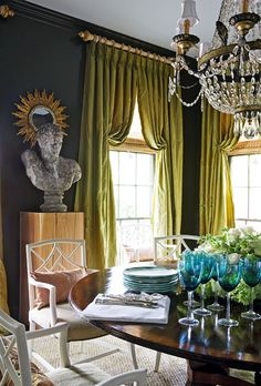Love the curtains. source: R Higgins Interiors Green & blue dining room with dark teal walls paint color, green silk pinch-pleat window panels curtains, gold sunburst mirror, crystal chandelier, round dining table and white lattice chairs. Decor, Green Curtains, Dining Room Blue, Teal Walls, Interior Design, Charcoal Walls, House And Home Magazine, Home Decor, Eclectic Dining Room