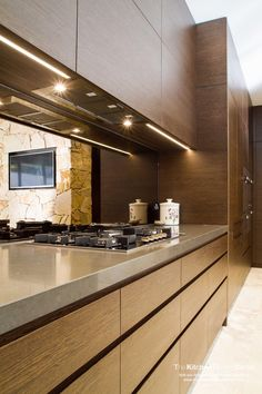 An incredible, modern home using timber veneer. Kitchen, pantry, bathrooms, robes and study. www.thekitchendesigncentre.com.au @thekitchen_designcentre