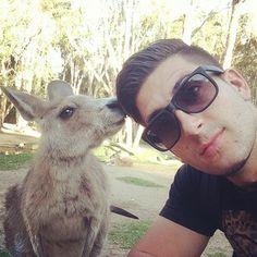 Jesse kicking it with a kangaroo in Australia.