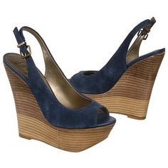 Get out and be seen in the chic blue BONITA wedge sandals from Fergie.