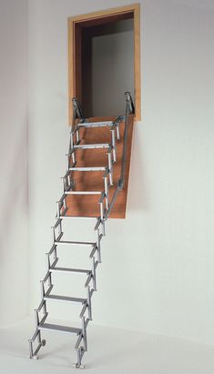 Columbus DSC Exklusiv Vertical Wall Access Aluminium Concertina Loft Ladder -- Manufactured from die-cast aluminium, the ladder stores in an upright position inside the timber hatch box supplied. It is suitable for floor heights from 2250mm to 3390mm and a range of loft opening sizes are available. It comes spring assisted for ease of operation. The ladder treads measure 140mm deep and 350mm wide (other sizes available). Optional telescopic handrails are also available. # From £1295.00 + VAT