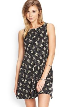 Cute and casual, this polka dot skater dress features a floral print and round neckline. Rock thi...