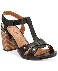 8d53c1d27 Studded leather lends edgy appeal to this sandal featuring a stacked heel  to boost your ensemble.